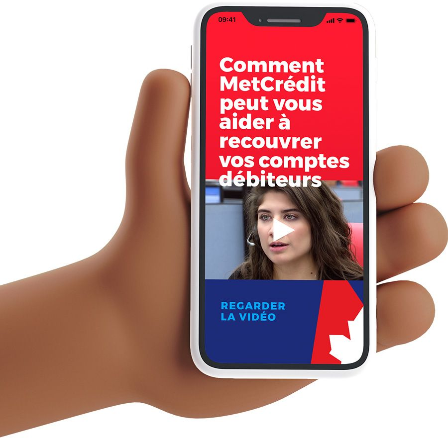 Hand holding cell phone with MetCredit website